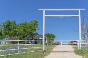 swing gate ranch entrance split rail metal fencing